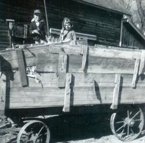 #168=Elliott&Candi in corn wagon; Oct. 1961