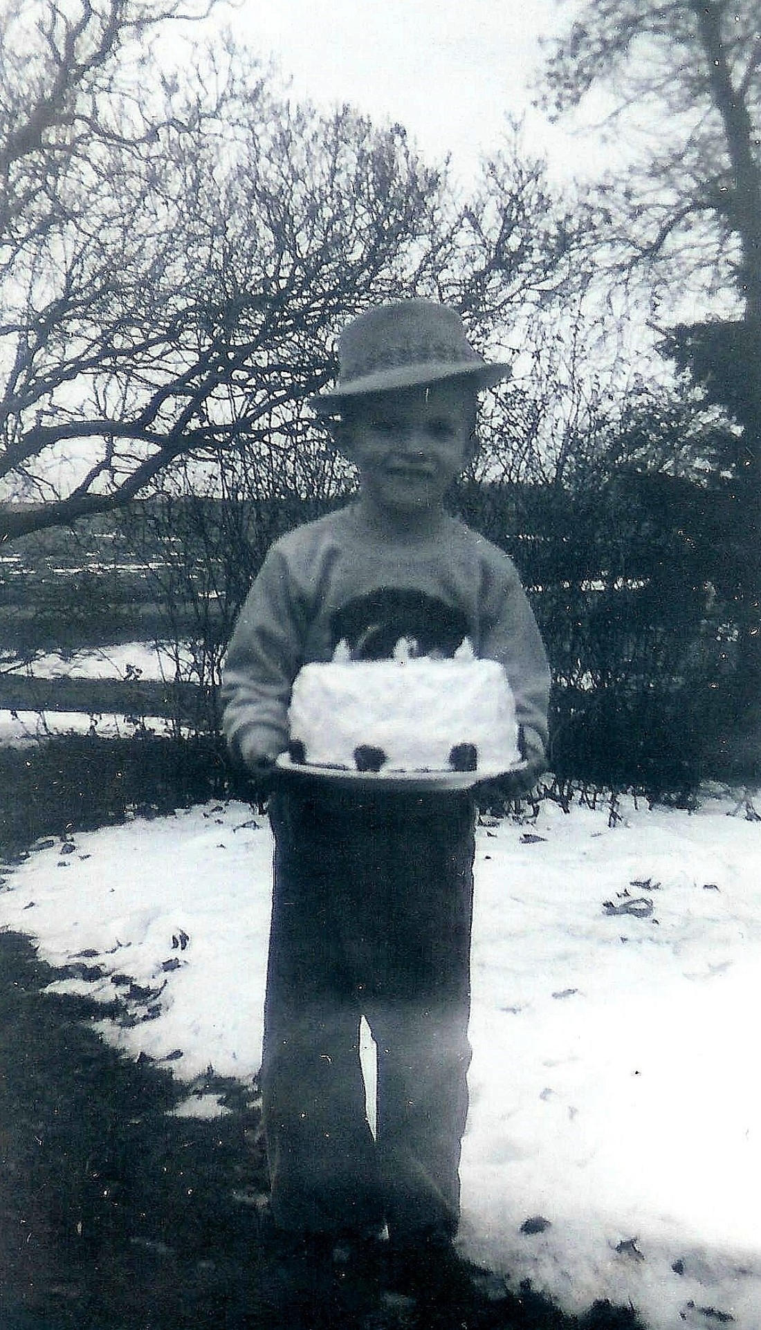 #107=Elliott with fedora hat on 6th BD; January 14, 1960