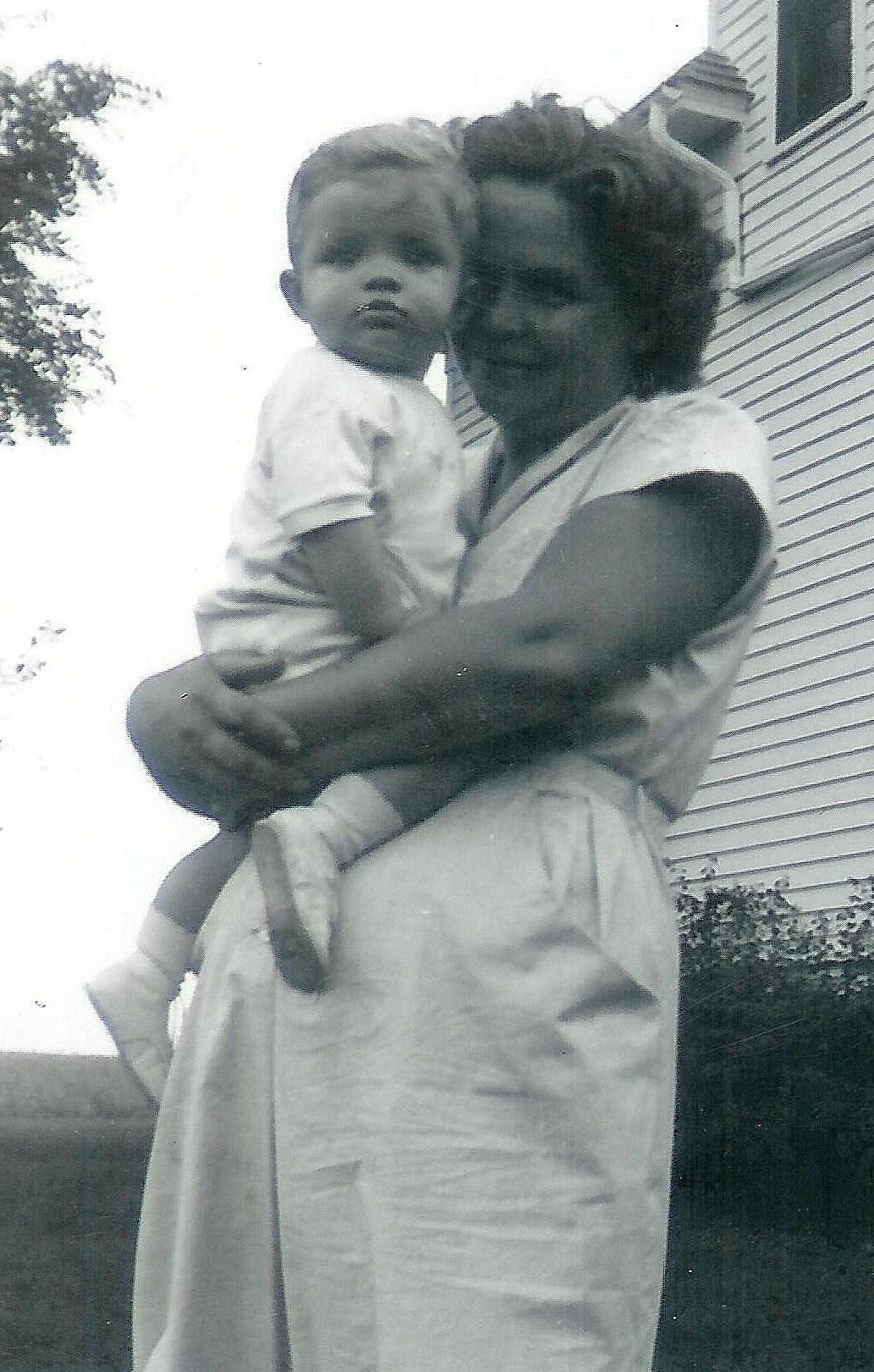 #144=Elliott in Mom's arms; circa September 1954