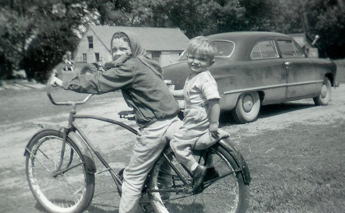 #79=Elliott & Rosemary on bike near blue '49 Ford