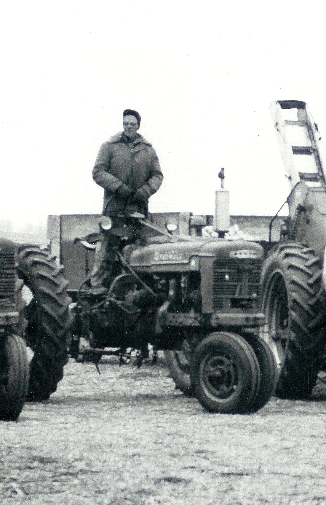 #98.1=Closeup of Russ on tractor, 1962