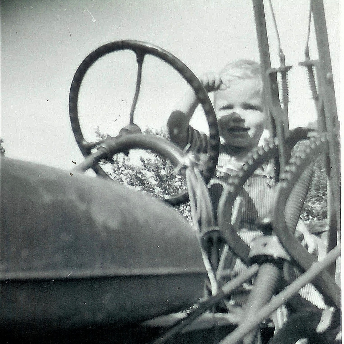 #108=Elliott on tractor, circa 1957