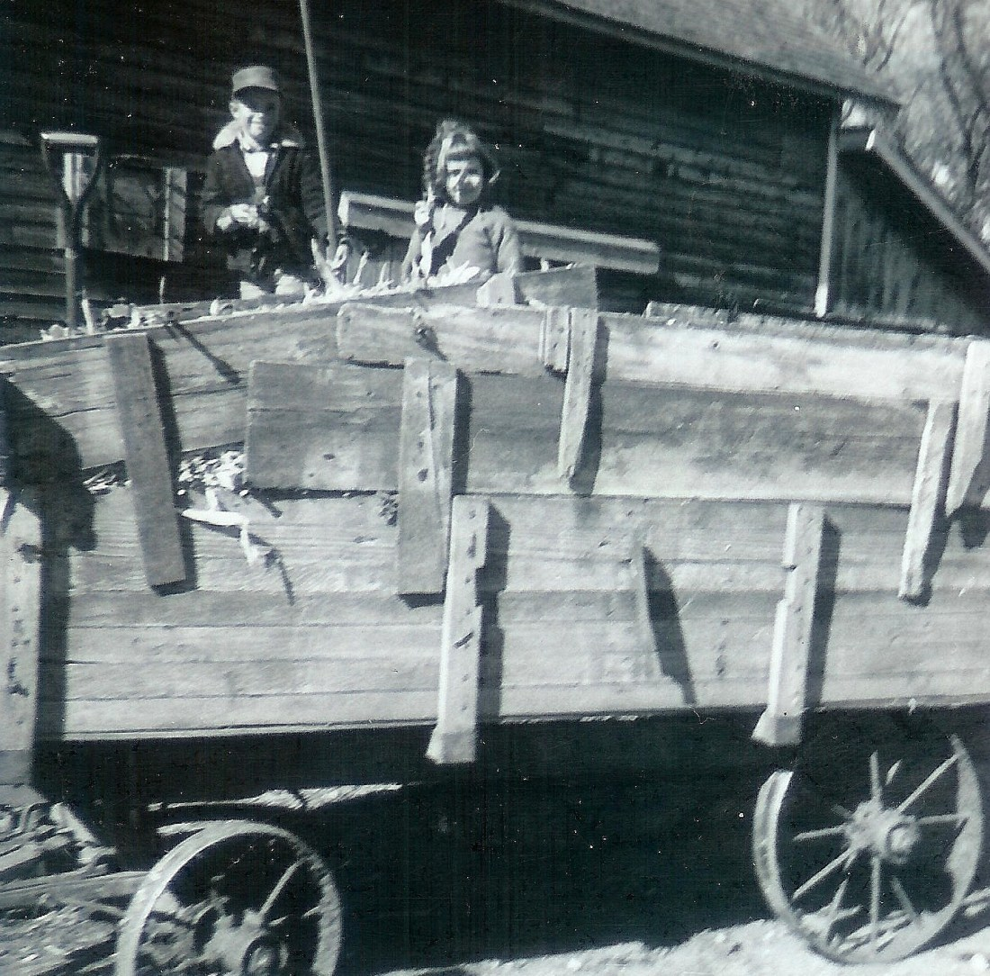 #168=Elliott&Candi in corn wagon; Oct. 1961