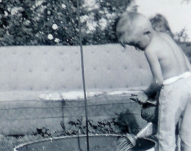 #94=Elliott watering flowers on farm, 1963 maybe