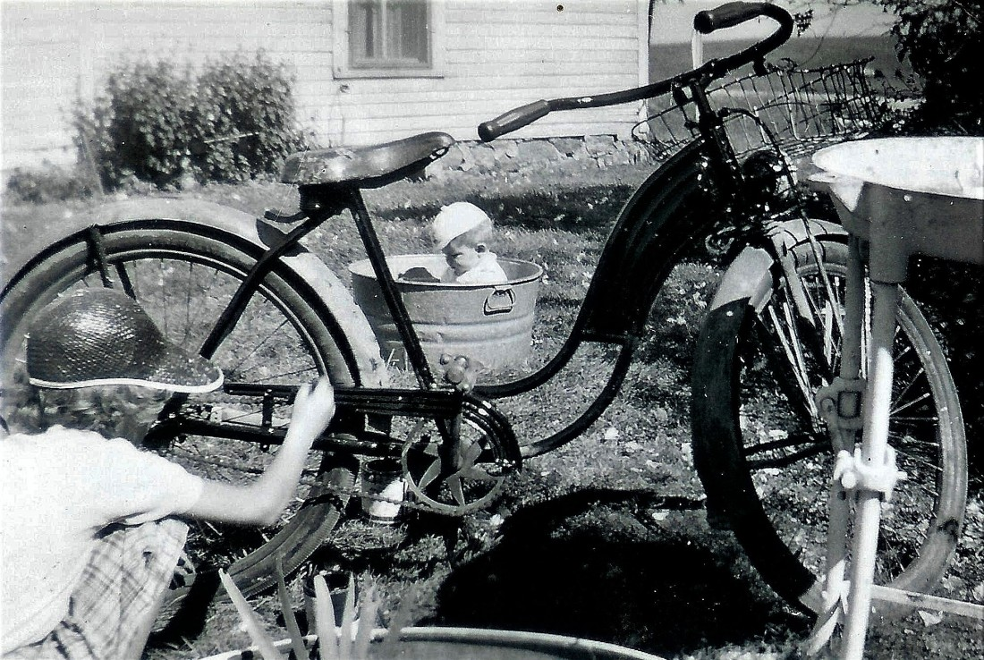 #110=Elliott in playpen tub with Rosie painting bike, circa 1955