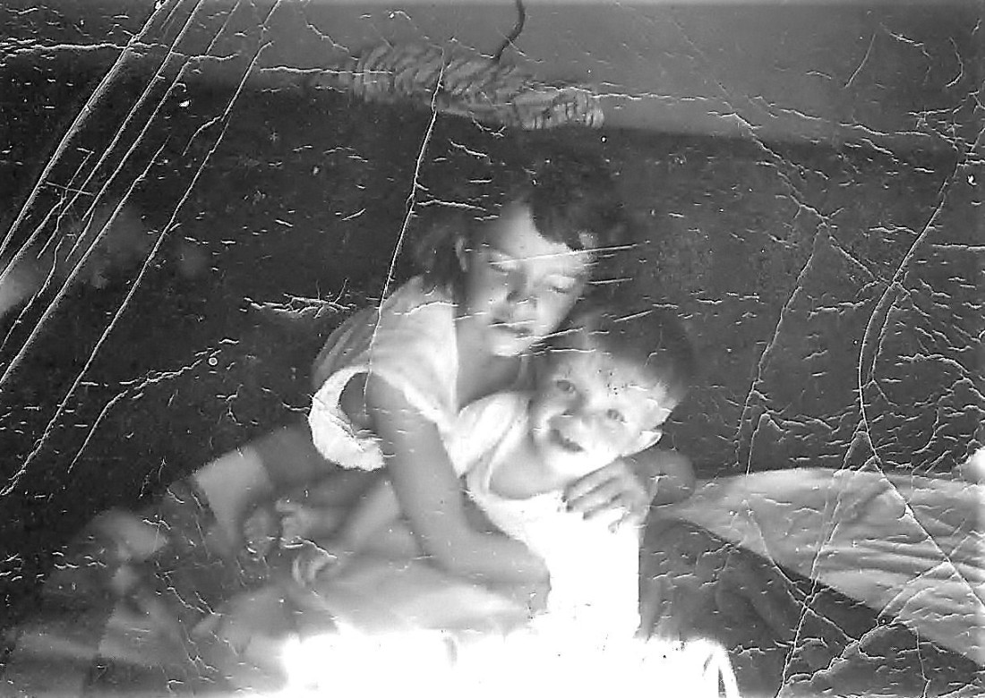 #49=Elliott & Rosie (circa March 1955) on couch in living room.