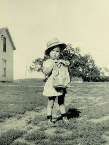 #80=Rosemary holding Dad's lunch bag, circa 1949