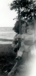 #103=elliott in tree swing with rosemary; aug. 31, 1954
