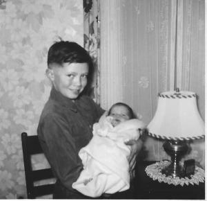 #898 lowell holds baby elliott 2.14.54 one month old.
