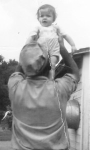 #01=Elliott held above Dad's head; September 1954
