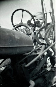 #108=Elliott on tractor, circa 1957