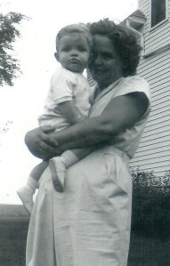 #144=Elliott in Mom's arms; circa September 1954
