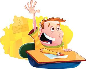 School boy eagerly raising his hand at his desk.