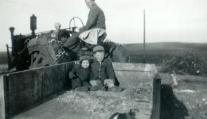 #277=Russ giving Lowell&Rosie ride in wagon; circa 1948
