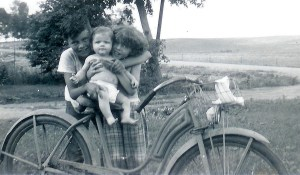 #57=Elliott on bike seat with Lowell & Rosie(Summer 1954)