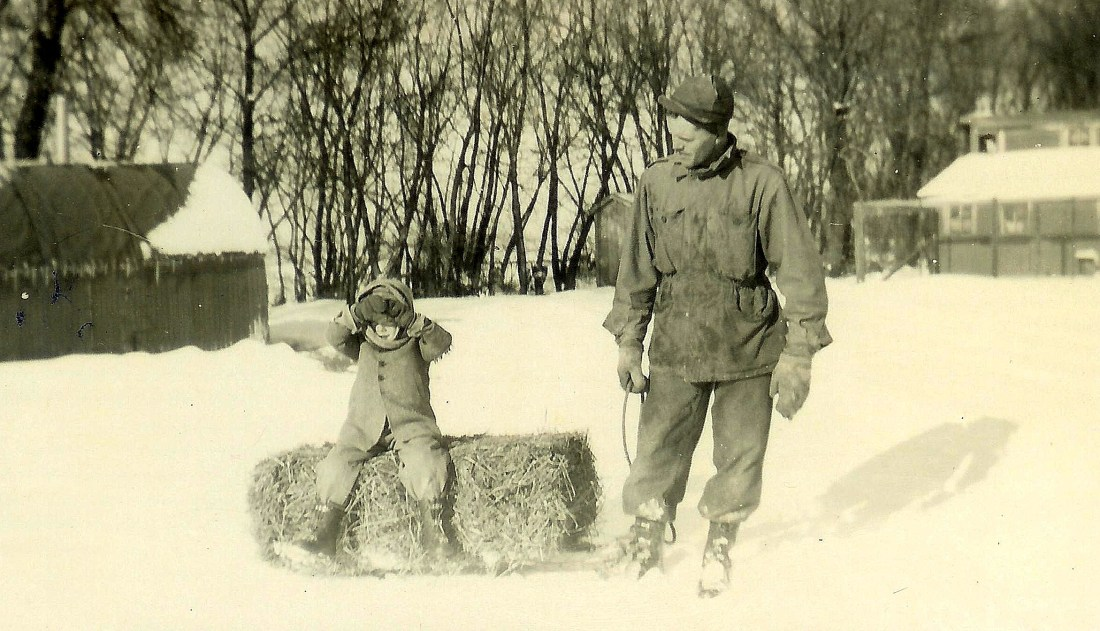 #159=Lowell on sled with bale; circa Winter 1947