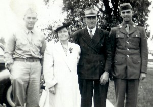 #292=G&G Sletten with boys. Del just finished boot camp; circa 1943