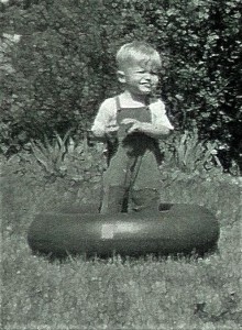 #150a=Elliott in innertube in front yard, circa 1957