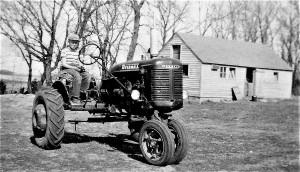 #46=Lowell on B Farmall (April 1954)