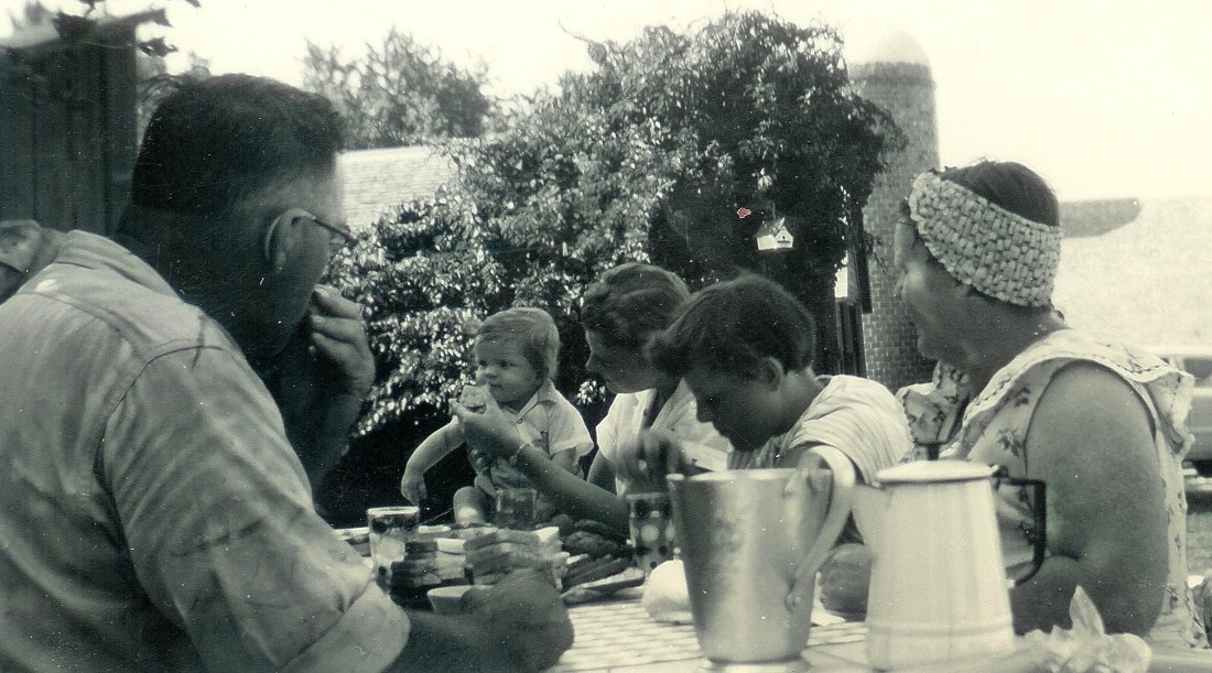 #58=Elliott on Ozmun's picnic table, July 7, 1954