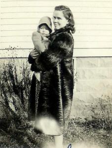 #343=Clarice N. holding Lorraine N.; November 1942