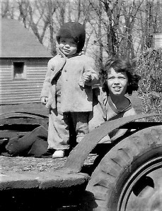 #45.1=Elliott & Rosie on hay wagon(March 1955)